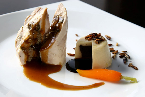 """Ballotine of d'Angola chicken stuffed with the tight and mushrooms, petit gateau of 'White and Black' beans and 'Wild' rice crisp"""